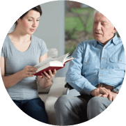 young lady holding book with old man